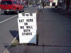 Playful restaurant sign on the street