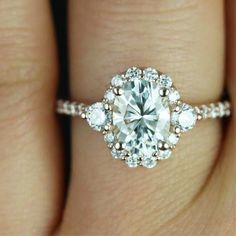 An oval diamond ring with a platinum and diamond band