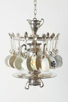 """Tea Time Chandelier: """"Eighteen vintage teacups dangle from an arrangement of vintage silver serving trays, utensils and the teapot itself, and lights. Perfect for a kitchen Eclectic Chandeliers, Silver Serving Trays, Silver Trays, Do It Yourself Home, Home Lighting, Lighting Ideas, Vintage Silver, Kitsch, Tea Time"""