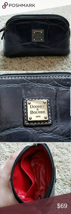 Dooney & Bourke Mini Bag Black leather coin purse/small makeup bag. Red liner and pocket inside. Approx. 5 inches wide by 3 deep. Dooney & Bourke Bags Cosmetic Bags & Cases