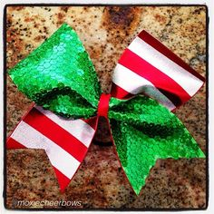 """Cheer bow of the day. by @moxiecheerbows """"May your days be merry & bright! #christmas"""" Tag #cheerbowoftheday to be featured. #cheerbow #cheerbows #holidays #cheer #cheerleading #cheerleader #cheerleaders #allstarcheer #santa #allstarcheerleading #cheerislife #bows #hairbow #hairbows #bling #hairaccessories #bigbows"""