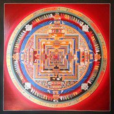 Kalachakra Mandala. This hand painted Thangka represents the wheel of time or Kalachakra in Tantric Buddhist philosophy. This Mandala brings balance and inner peace.