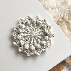 A fun and simple coaster with lots of texture! Try out some new stitches in this small project! You'll make front post stitches, bobbles and work through backloops! A perfect project to try new things but still fun for the more experienced crocheter!