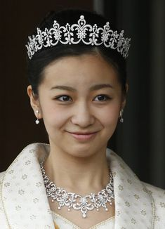 Japan's Princess Kako at the Imperial Palace in December 2014 celebrating her 20th birthday. Tiara, necklace earrings, bracelet and brooch by Mikimoto.