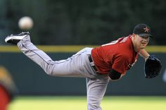Bud Norris fires a fastball past the Rockies Carlos Gonzalez. Love the follow through!