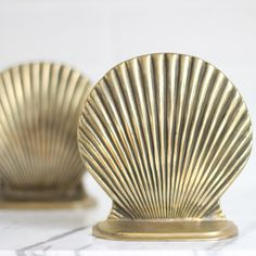 Vintage Brass Bookend Pair / Brass Seashell Bookends / Beach House Decor / Bookshelf Decor / Hollywood Regency Decor by LeftCoastRevivals on Etsy https://www.etsy.com/listing/270868187/vintage-brass-bookend-pair-brass