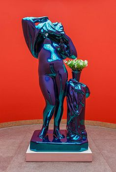 JEFF KOONS  Metallic Venus, 2010–12  High chromium stainless steel with transparent color coating and live flowering plants  100 x 52 x 40 inches  254 x 132.1 x 101.6 cm   Ed. 3/3