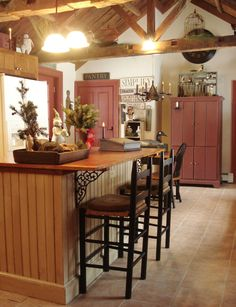 Love this kitchen, island, vaulted ceiling, and beams!