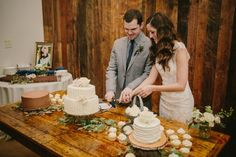 A Heritage House Wedding | Cake table setup at the end of the Barn | PhotoHouse Films | Heritage House Dripping Springs |