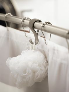 NEW SHOWER ROD HOOKS FROM MOEN® KEEP NECESSITIES CLOSE AT HAND IN THE BATH