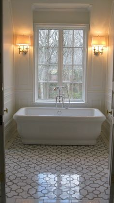 For the little dormer alcoves in older homes... Turn that tiny space into a wash room. Plus, this tile is to die for.