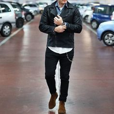 Black leather biker jacket and black chinos feel perfectly suited for weekend…