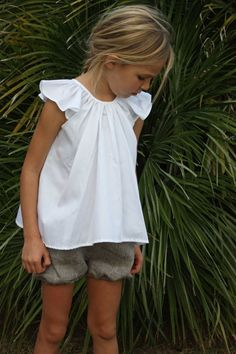 Linen shorts, white cotton top. Summer style for little girls. Club Cinq has super cute clothing for kids.