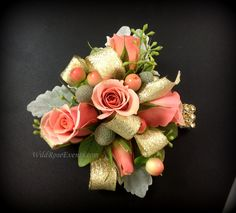 Mother's wrist Corsage with Coral Spray roses, hypericum, brunia, seeded Euc and dusty miller  @wildroseevents.com #weddingflowers #corsage #texas