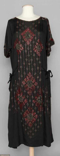 1920s BEADED FLAPPER DRESS  Black silk w/ red  brown beads in abstract floral pattern.