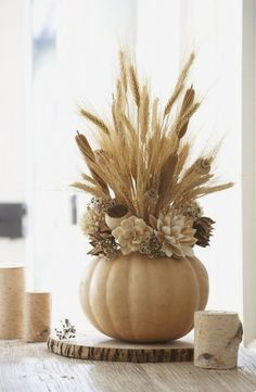 Ideas Original to decorate your table this season 20 DIY Thanksgiving crafts to decorate your table - fall harvest arrangement in a white pumpkin as a table centerpiece Ideas Original to decorate your table this season Pumpkin Centerpieces, Thanksgiving Centerpieces, Thanksgiving Crafts, Centerpiece Ideas, Pumpkin Vase, Pumpkin Flower, Wedding Centerpieces, Pumpkin Planter, Table Centerpieces