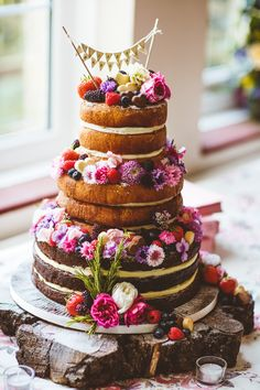 Naked Cake Victoria Sponge Layer Berries Fruit Flowers Bunting Log Pretty DIY Outdoor Village Hall Wedding https://photography34.co.uk/