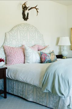Bedroom Decorating Ideas. Elegant Bedroom Decor! #BedroomDecor #Bedroom Paint Color Benjamin Moore White Swan, bed is Schumacher Chenonceau in aquamarine. Lamp is Robert Abbey and pillows are in Schumacher Chain Link in Cerise.