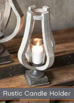 A truly artistic piece, this pillar-style candle holder is framed by sculptured natural wood for an organic twist on mixed media. The rustic metal is echoed in the base as well as the votive, tying the natural elements together.