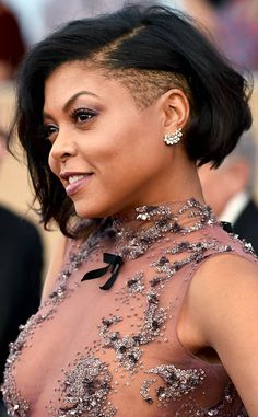 Taraji P. Henson from Best Beauty Looks: SAG Awards 2017  This daring hairstyle is incredible paired with such a feminine, yet sexy, dress. Her look is as multidimensional as her characters—perfect for the SAG Awards red carpet.