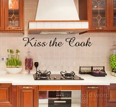 Hey, I found this really awesome Etsy listing at http://www.etsy.com/listing/55309398/kiss-the-cook-kitchen-decor-decal-vinyl