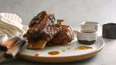 """This hearty recipe is adapted from """"Memories of Philippine Kitchens: Stories and Recipes From Far and Near,"""" by Amy Besa and Romy Dorotan These short ribs are quite simple to prepare, and after about 2 hours of braising, you end up with intensely flavorful, tender meat that falls from the bone."""