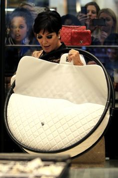 Kris Jenner went shopping, and experienced the best photobomb of all time. Also, the hell kinda purse is that?
