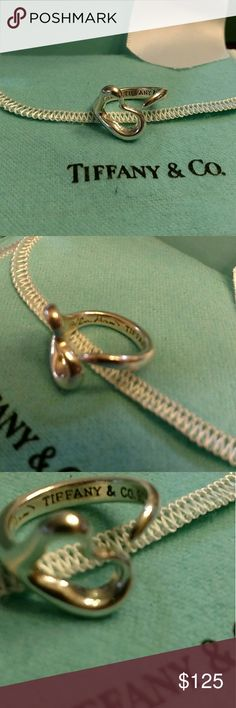 Tiffany & Co Elsa Peretti open heart ring This ring is sizable. I take all my items to T& Co  to be cleaned, polished and authenticated before I sell them, as shown in last photo. If you want a discount please use my bundle option.  Please see all photos for full description and details. Tiffany & Co. Jewelry Rings