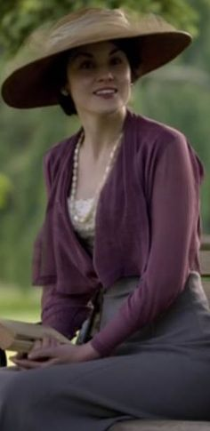 Lady Mary wearing her wide-brimmed summer straw swirled w/ netting for walking outside in the garden