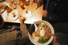 Established by chef and founder David Chang, Momofuku includes restaurants in NYC, Sydney, Toronto and Washington, DC. Best Restaurants In Toronto, York Restaurants, Steamed Pork Buns, Restaurant New York, Chang Restaurant, Noodle Bar, Canadian Food, Asian Recipes, Tips
