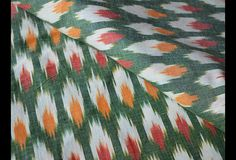 Ikat Weaving Cotton Fabric in Red, Green, White and Orange. You can use this fabric to make dresses, tops, Crafting, Drapery, Home Décor, Outdoor, Quilting, Sewing, General, Upholstery...