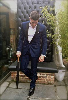 The Gentleman in a Moschino Navy Blue Tuxedo, Calvin Klein Dress Shirt, Kurt Geiger Patent Footwear and carrying a Fulton Italian-wood handle umbrella - Crazy Bear, Beaconsfield - Tomas Ellis