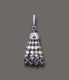 FROM THE ESTATE OF DORIS DUKE, A BELLE EPOQUE SAPPHIRE AND DIAMOND TASSEL PENDANT The diamond collet tassle, terminating in square-cut sapphire trim, suspended by a pavé-set diamond and triangular-cut sapphire cap, to the square-cut sapphire link and single-cut diamond bail, mounted in platinum, circa 1905. Edwardian Jewelry, Vintage Jewelry, Antique Jewelry, Art Deco Diamond, Vintage Diamond, Sapphire Diamond, Sapphire Pendant, New Jewellery Design, Diamond Are A Girls Best Friend