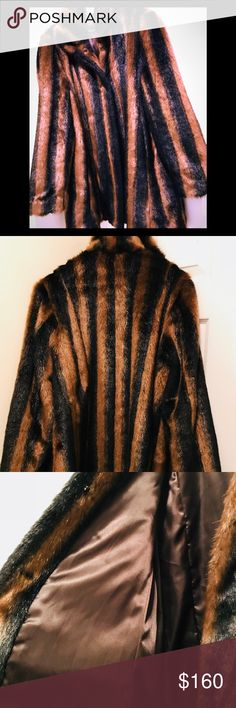 FAUX FUR FOX 3/4 LEGNTH COAT/ SZ MEDIUM This GORGEOUS FAUX FUR FOX COAT IS WORN ONKY ONCE TO TRY ON ( was too long for my taste) ITS BRAND NEW SHAPE TOTALLY...... it's SZ MEDIUM (8-10) has hidden hook closures and designed by SEVENTH AVENUE ..... It has black stripes running thru the dark brown and what I call Tiger brown hues IMG it's sooo pretty and I cried when it didn't fit me 😢😢😍😍so I'm hoping someone will love it!!! 💕💕 Retail price was $480.00😳😳😘👍🏼🌹👀 SEVENTH AVENUE Jackets…