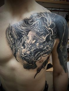 Dragon tattoo on breast black and grey by Mihail Sheykin - Körper-Tattoos - Best Tattoo Share Dragon Tattoo Chest, Dragon Tattoos For Men, Dragon Sleeve Tattoos, Japanese Dragon Tattoos, Japanese Sleeve Tattoos, Dragon Tattoo Designs, Tattoos For Guys, Black Dragon Tattoo, Picture Tattoos