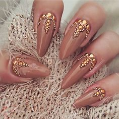 Nude/brownish nails with gold gems