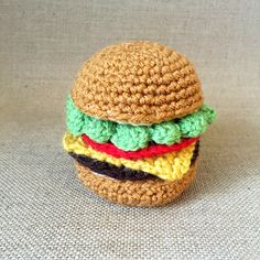 A free crochet hamburger pattern to create your own pretend play food, an eco-friendly, non-toxic toy that makes the perfect gift for kids.