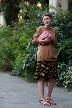 On the Street….via Creti, Florence Pull a sweater over a dress.