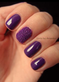 Purple nails with accent bead nail