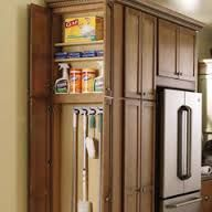 broom closet. Love this.  Wonder if there is space at the end of my cabinets for this!!!