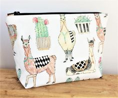 """This Fun Small Llama """"Wedge"""" Bag is perfect for all your makeup! Store it in your purse, bring it to work, or take it on your next vacation with you! This bag is perfect for organizing all your on the go makeup for everyday use! These Bags make beautiful gifts! Pattern placement"""
