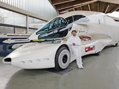 Designer Luigi Colani with one of his truck designs at the Colani Museum in Karlsruhe, Germany.  The aerodynamic design reduces fuel consumption. The driver sits in an aeroplane-style cockpit and controls the vehicle using a joystick and video cameras instead of a steering wheel and mirrors.