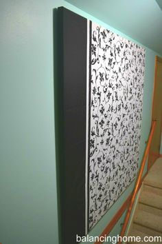DIY Large Wall Hanging made with a shower curtain... And put foam behind it and use it as a photo board!!!!!!!!!!!!