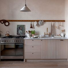 natural kitchen in neutral colours with oil painting portrait Inset Cabinets, Devol Kitchens, Neutral Kitchen, French Table, Swedish House, Slow Living, Kitchen Shelves, Kitchen Storage, Vintage Kitchen