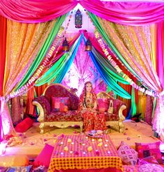 rainbow setting for a mendhi or sangeet indian wedding decor colours pink yellow gold red Arabian Party, Arabian Nights Party, Desi Wedding, Home Wedding, Wedding Mandap, Trendy Wedding, Wedding Receptions, Luxury Wedding, Elegant Wedding