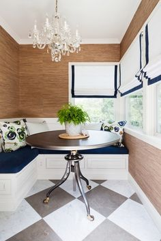 Breakfast nook with grass-cloth covered walls, roman shades with blue trim, built-in white banquette with blue welted cushions and patterned throw pillows «design :: taylor jacobson»