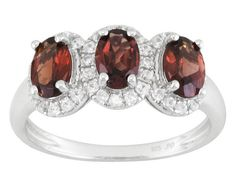 Garnet red is spectacular. And this setting exhibits the deep red in such a unique way. | 1.70ctw Oval Garnet With .45ctw Round White Zircon Sterling Silver 3-stone Ring