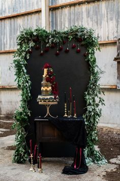 Turn your wedding cake into a true work of art by displaying it in front of its very own backdrop. This setup is gorgeously gothic chic — the greenery and gold details break up the burgundy and black color palette.- gothic + Halloween wedding inspiration Trendy Wedding, Fall Wedding, Our Wedding, Dream Wedding, Geek Wedding, Perfect Wedding, Wedding Black, Purple Wedding, Wedding Hair