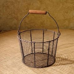 Large Wire Pail Basket, rustic and uniquely crafted for vintage charm with aged appearance. You can store bath cloths, dish cloths, fruit, just about anything in this adorable wire basket. Primitive Country Farmhouse Home Decor. Farmhouse Chic, Vintage Farmhouse, Country Farmhouse, Primitive Carrots, Wire Egg Basket, Vintage Stationary, Large Baskets, How To Make Pillows, Basket Decoration