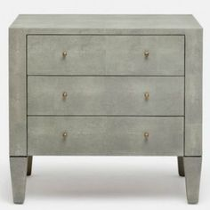 The castor gray colored Sorin 3-Drawer Double Nightstand from Made Goods is unique in that is works equally well as a nightstand or dresser. Its faux shagreen exterior offers a subtle hint of luxury while antiqued brass knobs, bottom-mounted hardware, and self-closing glides complete a truly finished piece.
